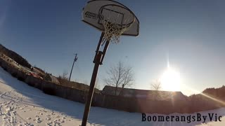 Amazing boomerang trick shot into basketball hoop - Video