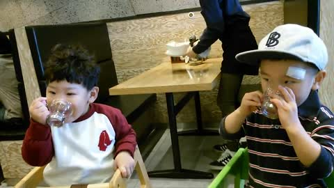 Adorable toddlers toast each other