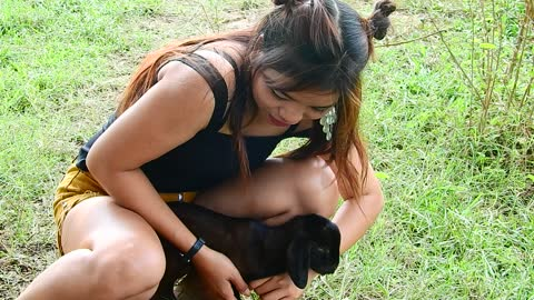 Cute Girl Do funny with goat very happy , beautiful girl love goat