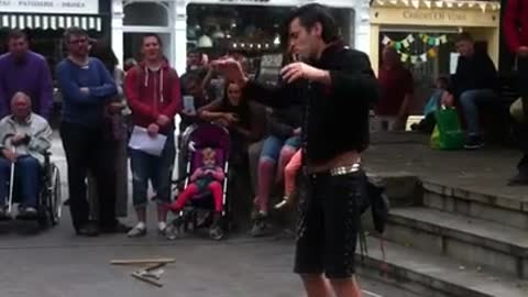Street Performer Swallows a Sword