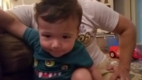 "Baby boy hilariously tries to say ""book"", too cute!"
