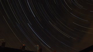 Star trail time laps over the roof tops.