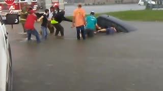 Men Rescue Woman From Car After Flash Flood - Video