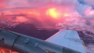 Flying Through A Sunset Storm Is One Glorious Experience - Video