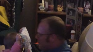 Baby plays peek-a-boo with her dad - Video