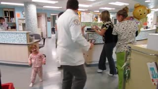 Doctors and nurses dance with sick child - Video