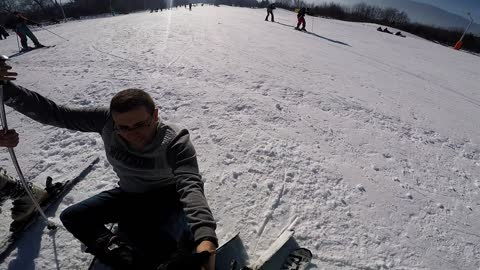 Friend falls from skis