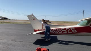 Strong woman moving plane