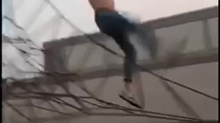 Shirtless jeans jump off black rope fail