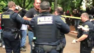 Violence breaks out in Portland as Antifa activists stormed a Patriot Prayer rally - Video