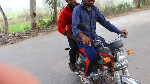 two bikers are doing crazy stunt with bike