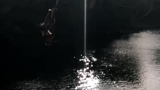 Shirtless guy faceplants in river off rope swing - Video