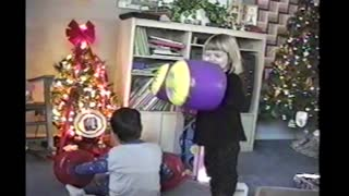 Boy Tricks Sister And Knocks Her Down With Inflatable Boxing Gloves
