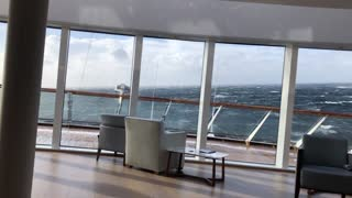 Waves Rock and Pound Cruise Ship off the Coast of Norway