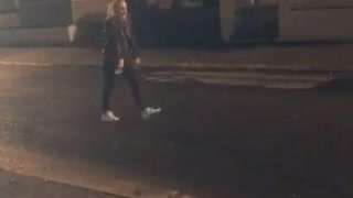 Girl barely misses side flip on street