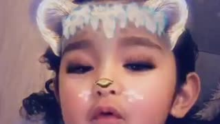 Little girl enjoys different snapchat animal filters  - Video
