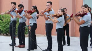 Mariachi students playing a Mexican song.