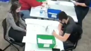 Poll Worker Filling Out Ballots
