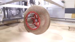 NASA Created An Airless Chainmail Tire That Transforms Shape - Video