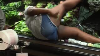 Woman Bathes in Produce at Supermarket - Video