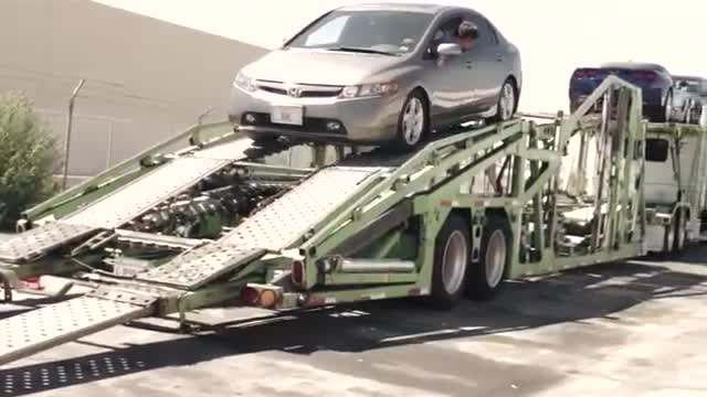 Loading a Car Carrier: A Brief Inside Look