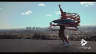 Talented Woman Is Synced With 180 Hula Hoops In One Go - Video