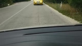 Crazy driver drives backwards down road - Video