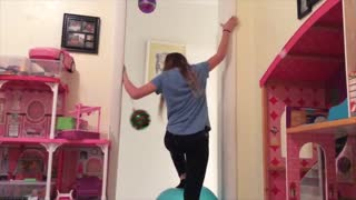Girl Tries Balancing On Exercise Ball and Falls - Video