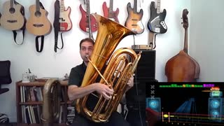 Watch this musician use a tuba to play (and dominate) 'Rocksmith' video game