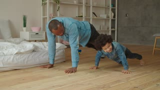 Father and son doing push-ups together