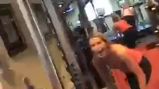Girl trying to do squats drops weights  - Video