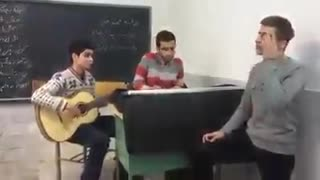 Students singing Morteza Pashai's song