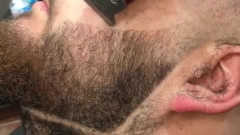 Epic beard transformation by talented barber