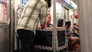 Guy performing magic out of small stroller box on subway - Video
