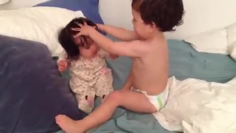 Toddler Lovingly 'Washes' Baby Sister's Hair