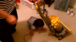 Toddler Has Adorable Tantrum When Her Parents Put The Vacuum Away - Video
