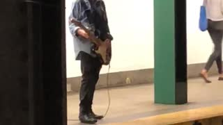 Guy denim jacket playing electric guitar subway  - Video