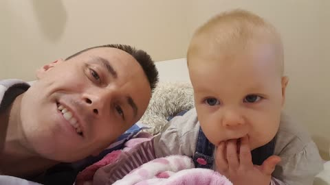 Adorable Baby Mimics Daddy and Giggles