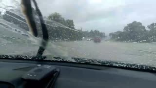 Driving through floodwaters  - Video