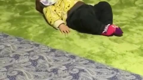 A child performing difficult acrobatic movements on the bed