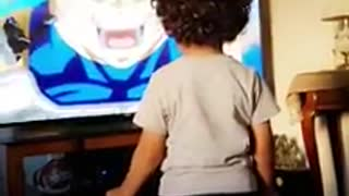 Super excited kid gets fired up for favorite cartoon