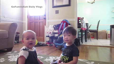 Precious toddler stops crying baby with kiss
