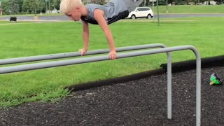 Little boy in grey playground front flip fall - Video