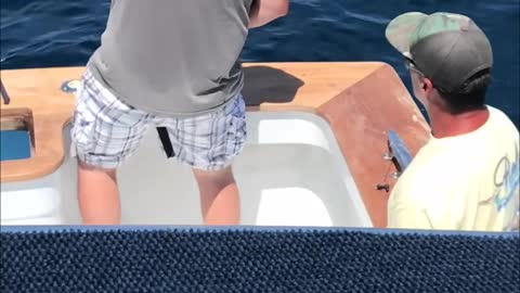 Fisherman Pulls His Friend's Fishing Pole To Make Him Believe He Has A Catch