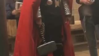 Man dressed as thor on subway station