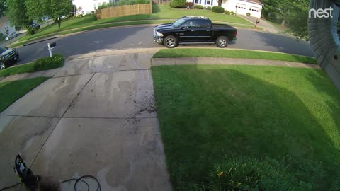 Wife sprays her husband coming home from work with the power washer and laughs
