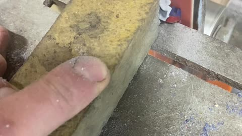 Turning a Nokia 3220 to Dust Using Belt Sander