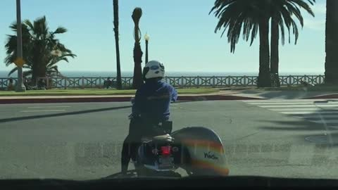 Motorcycle with a rainbow surf board