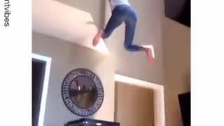Girl falls and breaks fish tank - Video