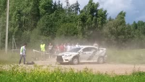 Rally car crashes, barely misses cameraman - Video